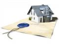 При разделе имущества супругов признание права собственности на часть дома гарантирует и право собственности на земельный участок, где он расположен